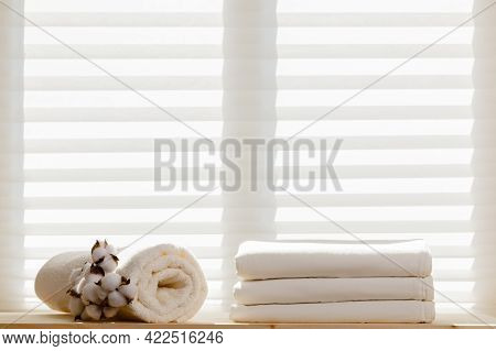 White Bed Linens Sheets Bedding And A Terry Towel With A Cotton Branch Against The Background Of The