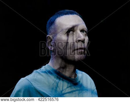 Creepy Man Portrait With Shadow From Blue Eye. Scary Look Of Mature Senior Modern Handsome Man. Madn