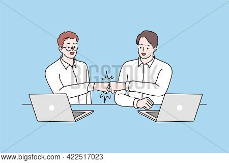 Success, Cooperation, Agreement Concept. Smiling Male Young Business Partners Workers Sitting And Sh