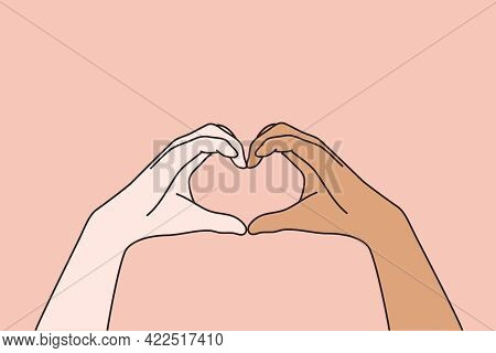 Multi Ethnic And Multicultural Love Concept. Hands Of White And Black Human People Forming Heart Mea