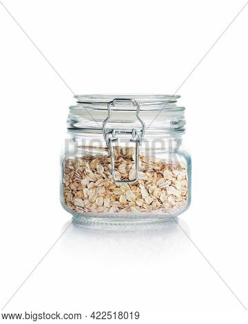 Rolled Oats In Glass Jar Isolated On A White Background.