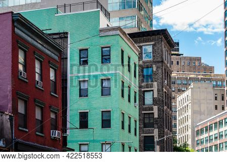 Traditional Colorful Painted Brick Houses In Nyc