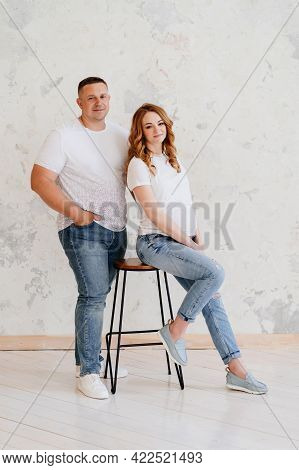 A Man And A Woman In White Waiting For The Birth Of A Child. Joint Births