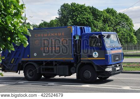 Moscow, Russia - May 30, 2021: Specialized Garbage Collection Vehicle On The City Streets. Garbage T