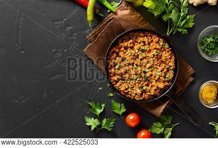 Keema Curry In Frying Pan Over Black Stone Background With Copy Space. Indian And Pakistani Style Di