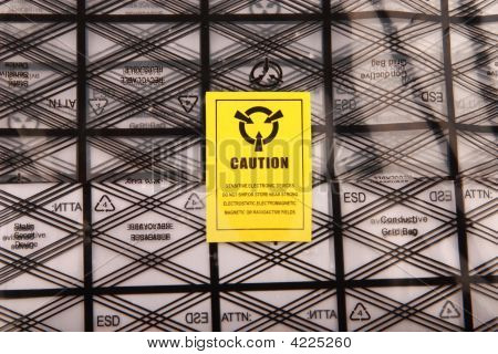 yellow caution label stick on plastic bag poster