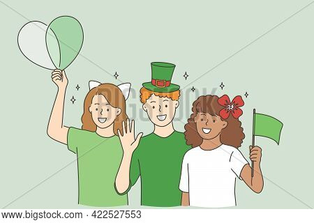 Celebrating Saint Patrick Day Concept. Group Of Cheerful Smiling Children Friends In Green Costumes