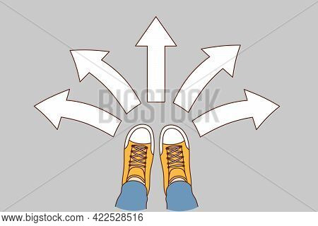 Choice And Decision Concept. Human Foot In Sneakers Standing With Arrows In Various Directions Aroun