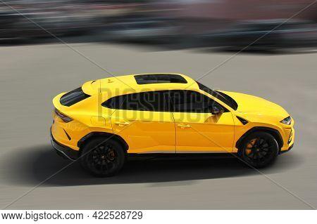 Kiev, Ukraine - May 22, 2021: Yellow Luxury Super Suv Lamborghini Urus In Motion. Lamborghini Urus S