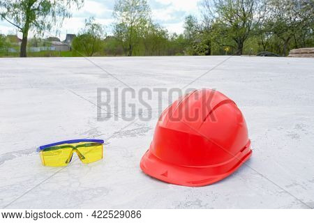 Construction Helmet And Construction Safety Goggles At The Construction Site. Construction Works