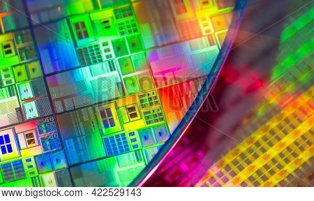 Silicon Wafer with microchips used in electronics for the fabrication of integrated circuits.