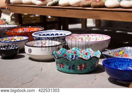 Traditional Albanian Plates. Deep Ceramic Painted Bowls On The Market In Gyroscaster, Colorful Plate