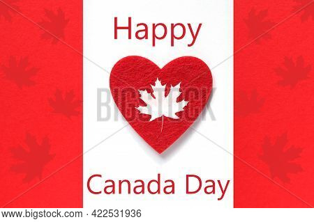 Happy Canada Day Greeting Card. Red Heart On Canada Flag