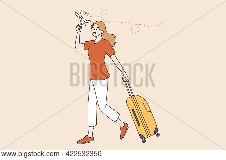 Traveling And Vacations During Covid-19 Pandemic Concept. Young Woman Walking With Suitcase Ready Fo
