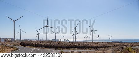 Panoramic View Of Windmill Farm At The Ocean Shore