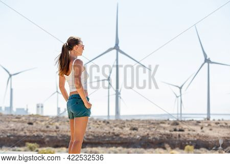 Young Woman Standing Near The Windmill Farm