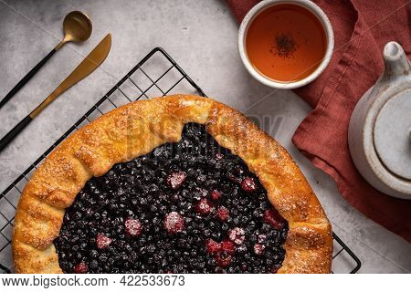 Homemade Blueberry Galette, Tart On The Table With Tea. Top View.