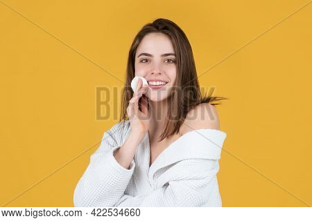 Girl Cleanses Face Holding Gentle Facial Sponge For Daily Exfoliation. Woman Beauty Face, Portrait O