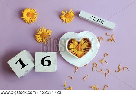 Calendar For June 16: The Name Of The Month Of June In English, Cubes With The Number 16, A Cup Of T