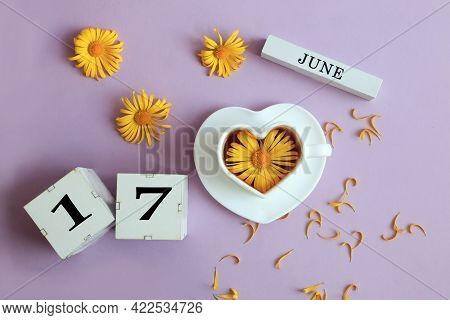 Calendar For June 17: The Name Of The Month Of June In English, Cubes With The Number 17, A Cup Of T