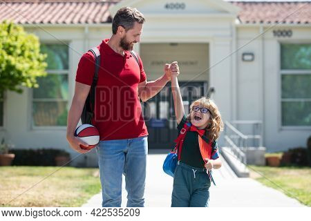 Dad And Child Go Hand In Hand. Beginning Of Lessons.