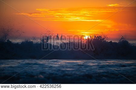 Yacht Sailing In An Open Sea At Sunset. Sunset At The Sea. Sunrise At Beach. Colorful Ocean Beach Su