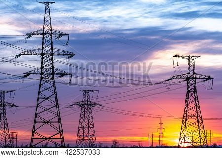 High-voltage Power Lines On The Background Of The Evening Sky. Transmission Of Electricity By Means