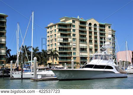 Boats And Yachts At The Pier In A Marina, Luxury Yachts In Protected Harbor