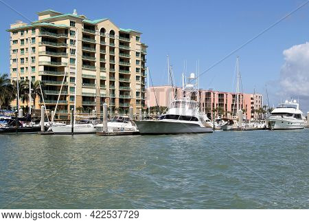 Boats and yachts at the pier in a marina, luxury yachts in protected harbour