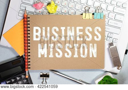 Business Concept.text Mission On Paper Board With Roots On Black Background