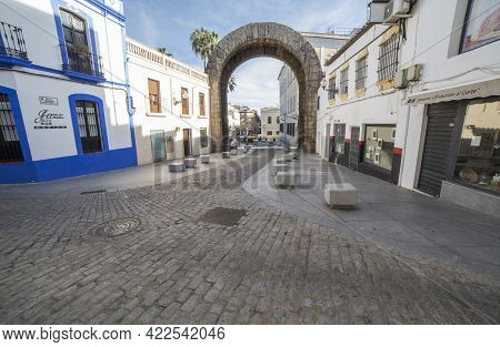 Merida, Spain - Feb 14th, 2021: Roman Arch Of Trajan, Monumental Access Gateway To Ancient Emerita A