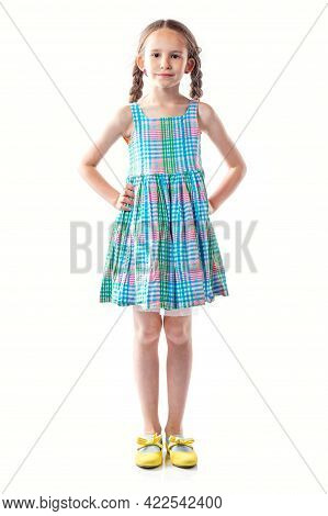 Cute European Little Girl In Colorful Dress With Pigtails Isolated On White Background