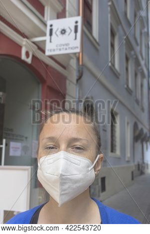 Woman Wearing A Medical Mask In Front Of A Covid Test Center For Antigen Or Pcr Tests During Coronav