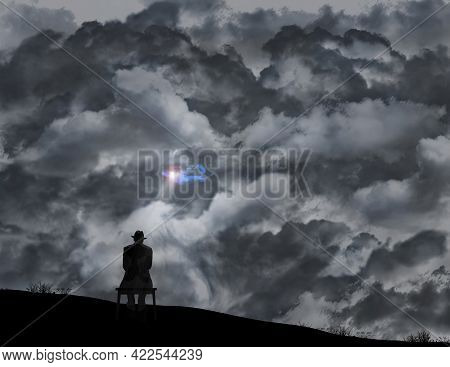 A Old Man In A Fedora Sits On A Bench Infront Of A Wall Of Storm Clouds But A Glimmer Of Sunlight Sh