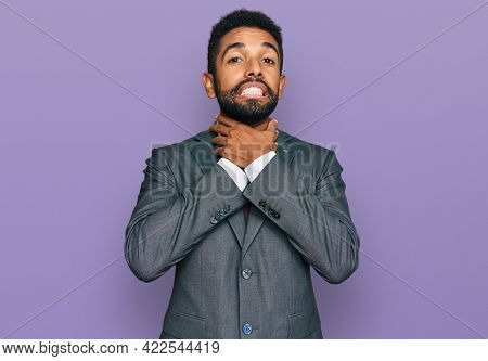 Young african american man wearing business clothes shouting and suffocate because painful strangle. health problem. asphyxiate and suicide concept.