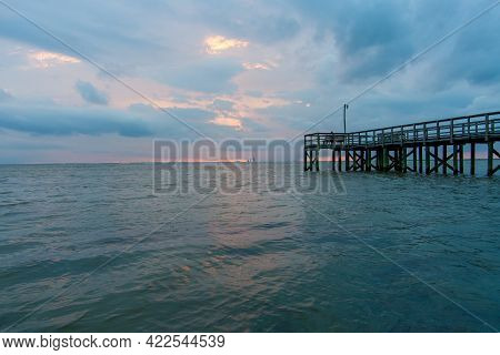 Mobile Bay Pier At Sunset On The Alabama Gulf Coast
