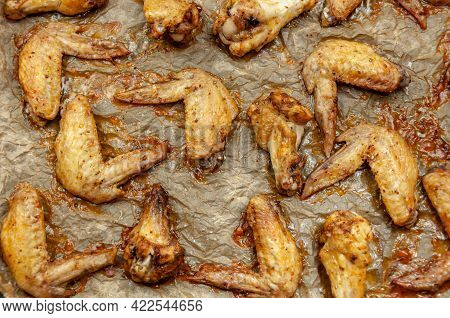 Hot And Buffalo Chicken Wings. Cooked Chicken Wings On Parchment Paper. Top View