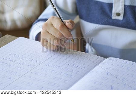 Primary School Kid Hand While Doing Maths Homework Writing, Excercise Education Lifestyle