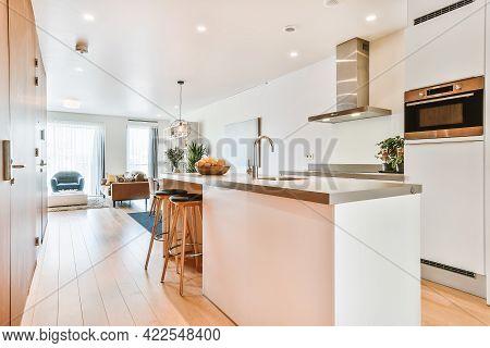 Home Interior Design Of Modern Loft Apartment With Open Kitchen In Minimalist Style