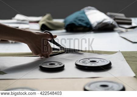 Tailor In Tailoring Shop Working. Closeup Of Fashion Designer Or Professional Seamstress Female Hold