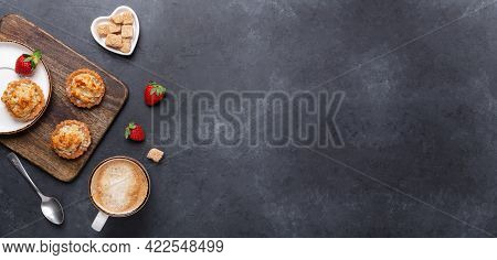 Cup Of Coffee, Cakes And Strawberries On A Wooden Cutting Board On Dark Stone Background. Horizontal