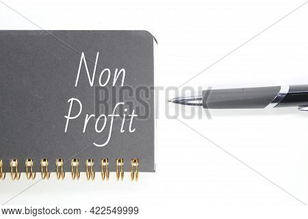 Pens And Non -profit Writing On Notebooks