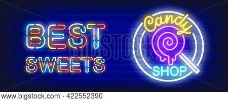 Candy Shop Neon Sign. Lollipop And Best Sweets Inscription On Brick Wall Background..night Bright Ad