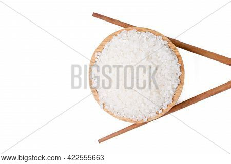 Isolated Top View Raw Rice. Raw Rice Japanese In Wooden Bowl With  Chopsticks White On Background. A