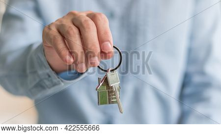House Key In Landlord, Real Estate Sale Person Or Home Insurance Broker Agent Hand Giving To Tenant,