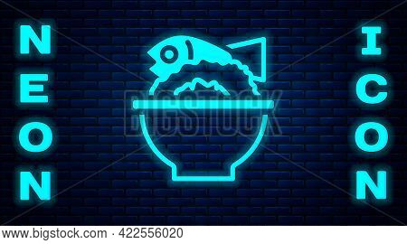 Glowing Neon Served Fish On A Bowl Icon Isolated On Brick Wall Background. Vector