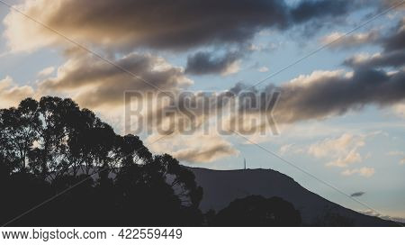 Beautiful Sunset Sky With Clouds Rolling Over The Mountains In Tasmania, Australia