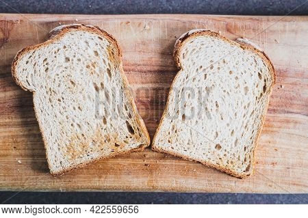 Slices Of Toasted Bread On Wooden Cutting Board, Concept Of Simple Natural Healthy Ingredients