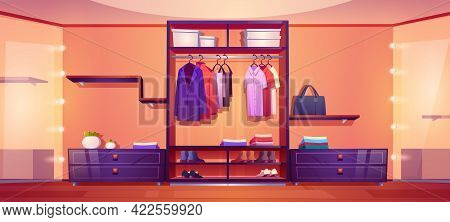 Modern Walk In Closet With Men Clothes And Shoes On Wardrobe Shelves, Hangers With Shirts And Coats.