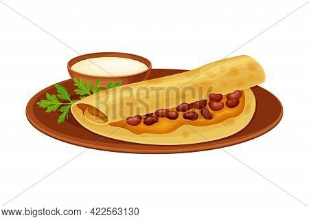 Stewed Beans Wrapped In Crumpet With Sauce Indian Dish And Main Course Served On Plate And Garnished